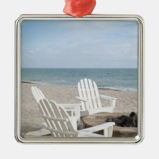 beachfront house with adirondack chairs and christmas ornament