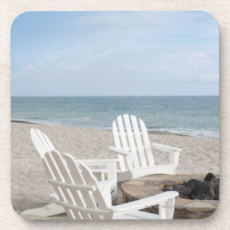 beachfront house with adirondack chairs and coaster