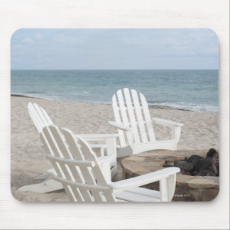 beachfront house with adirondack chairs and mouse pad