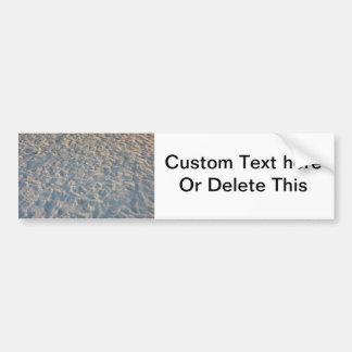 Beautful footprints all over beach sand, blue pink bumper sticker