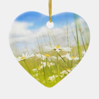 Beautifufl spring meadow background ceramic heart decoration