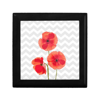 Beautiful blooming red poppies over grey chevron gift box