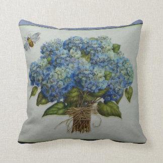 beautiful blue hydrangeas with a bee cushion