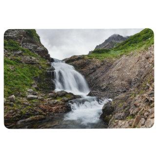 Beautiful cascade waterfall in mountain river floor mat