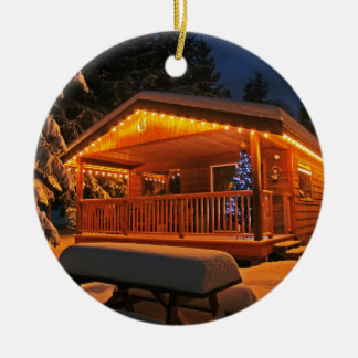 Beautiful Christmas Lights on Log Cabin in Snow Round Ceramic Decoration