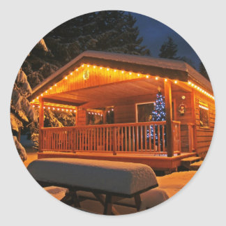 Beautiful Christmas Lights on Log Cabin in Snow Round Sticker
