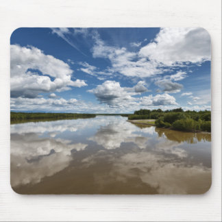 Beautiful clouds over river, reflection in water mouse mat