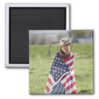 Beautiful cowgirl wrapped in American flag Magnet