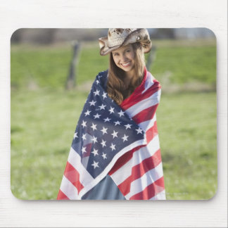 Beautiful cowgirl wrapped in American flag Mouse Pad