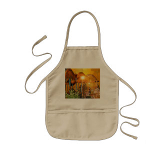 Beautiful elf sitting in the garden with flowers kids apron