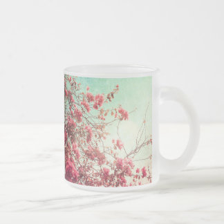Beautiful flowers in retro style frosted glass mug