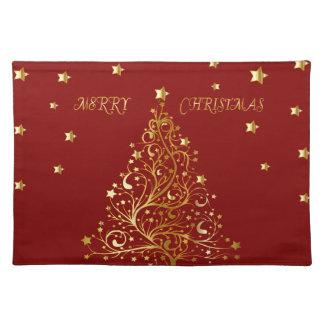 Beautiful metallic gold Christmas tree on dark red Placemat