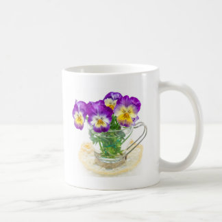 beautiful pansy flowers isolated in a cup