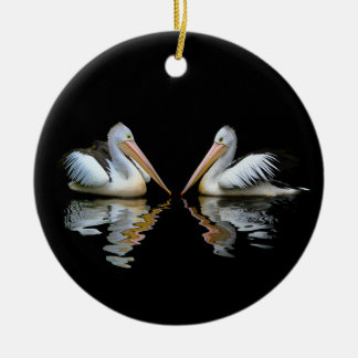 Beautiful pelicans reflection on black background christmas ornament
