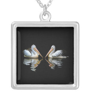 Beautiful pelicans reflection on black background square pendant necklace
