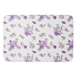 Beautiful purple flowers on bath mat