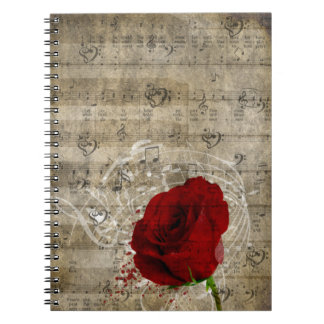 Beautiful red rose music notes swirl faded piano notebook