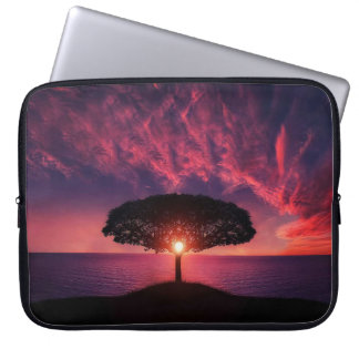 Beautiful scenery with the sun rising behind a tre laptop sleeve