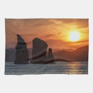 Beautiful seascape: three rocky island at sunset hand towels