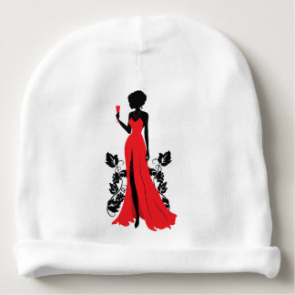 Beautiful silhouette of young woman with wineglass baby beanie