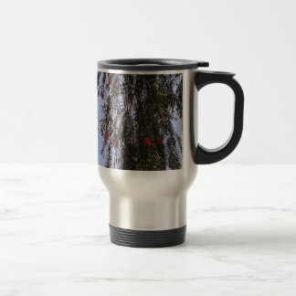 Beautiful small red flowers on a tree branch stainless steel travel mug
