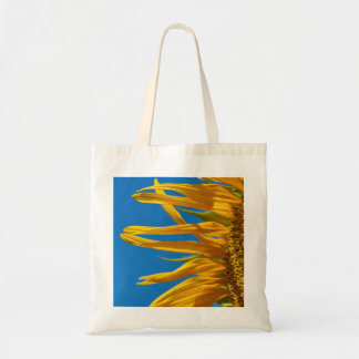 Beautiful sunflower in front of a blue sky; summer tote bag
