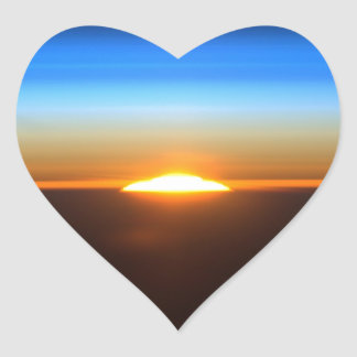 Beautiful sunrise in space heart sticker