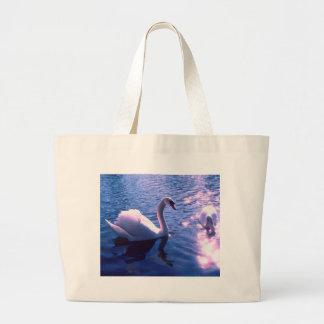 Beautiful swan in lake tote bags
