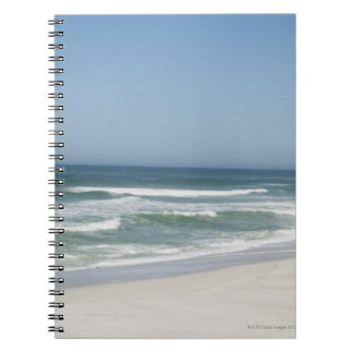 Beautiful view of beach against clear sky 2 notebooks