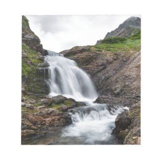 Beautiful waterfall in cold mountain river notepad
