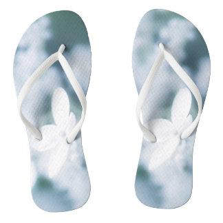 Beautiful white blossoms flip flops