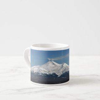 Beautiful winter panorama of volcanoes espresso cup