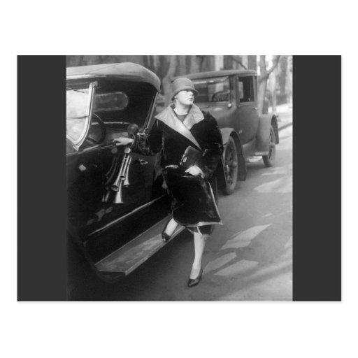 Beautiful woman and cars, 1920s postcard