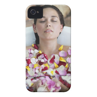 Beautiful young woman relaxing in bathtub with iPhone 4 cases