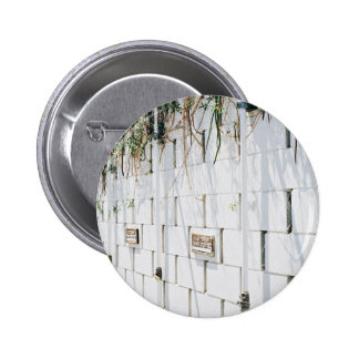 Beauty Themed, A Concrete Wall With Few Plates Nai 6 Cm Round Badge