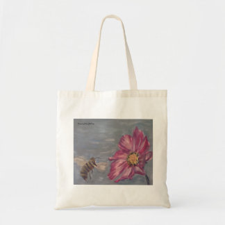 Bee buzzing on a prairie wildflower in the garden tote bag