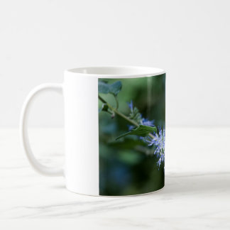 Bee flies on flower coffee mug