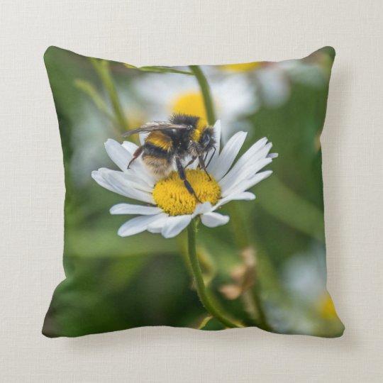 Bee on a white daisy throw cushion