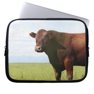 Beef cow in field laptop sleeve