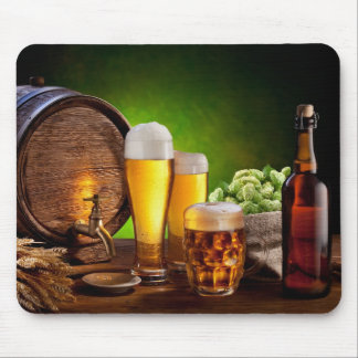 Beer barrel with beer glasses on a wooden table mouse mat