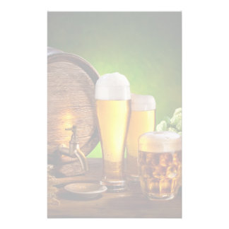 Beer barrel with beer glasses on a wooden table stationery