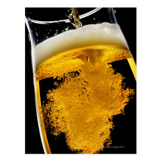 Beer been poured into glass postcard