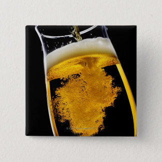 Beer been poured into glass, studio shot 15 cm square badge
