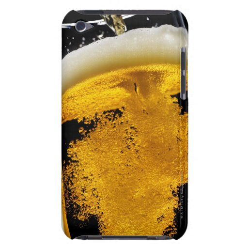 Beer been poured into glass, studio shot Case-Mate iPod touch case