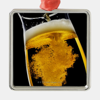 Beer been poured into glass, studio shot christmas ornament