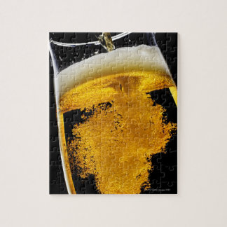 Beer been poured into glass, studio shot jigsaw puzzle