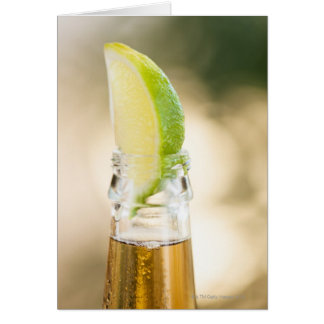 Beer bottle with lime wedge greeting card