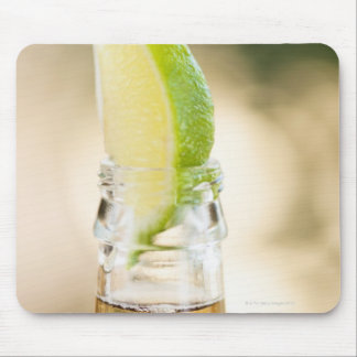 Beer bottle with lime wedge mouse mat