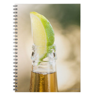 Beer bottle with lime wedge notebook