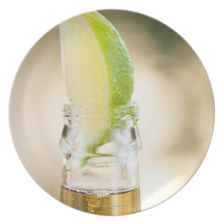 Beer bottle with lime wedge plate